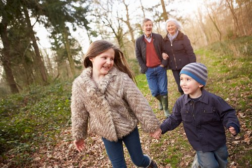 Grandparents with their grandchildren out on a walk. | Source: Shutterstock.