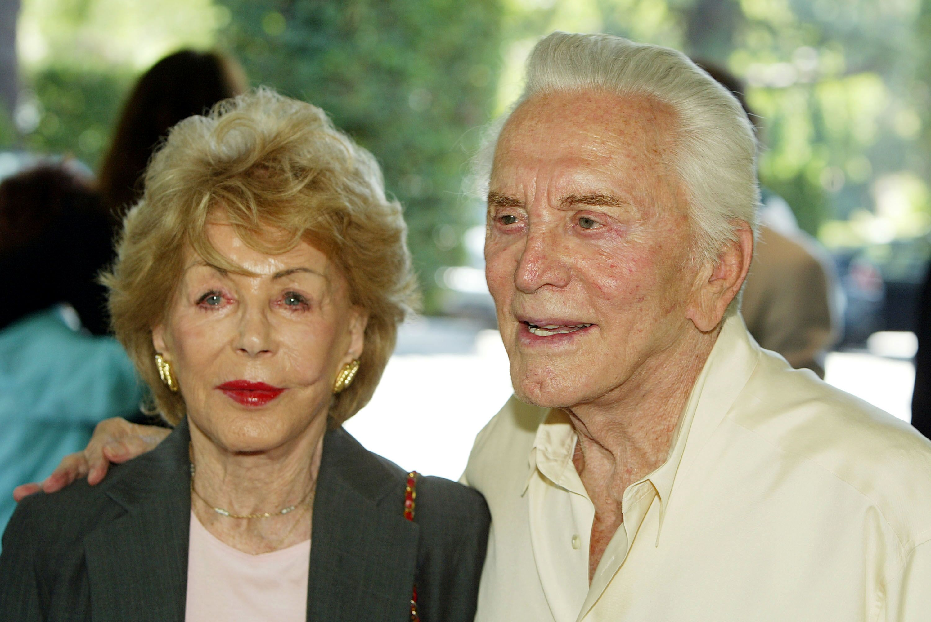 Kirk Douglas and his wife Anne arrive at the annual Hollywood Foreign Press Association installation luncheon. | Source: Getty Images