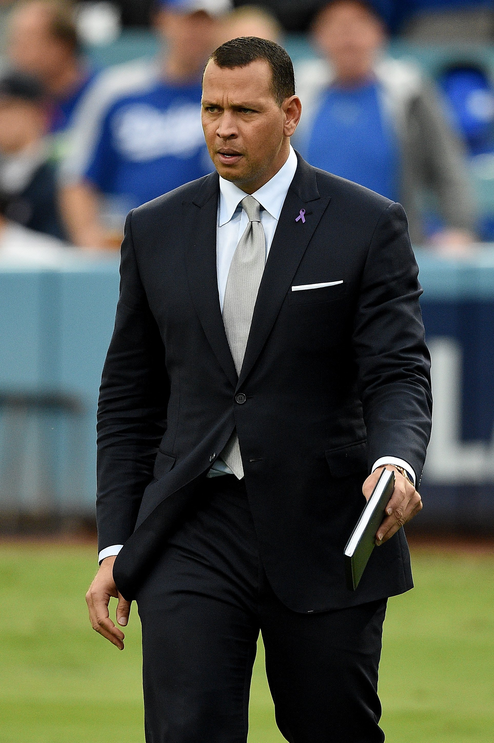 Alex Rodriguez walking before game six of the World Series between the Houston Astros and the Los Angeles Dodgers at Dodger Stadium on October 31, 2017 in Los Angeles, California | Photo: Getty Images