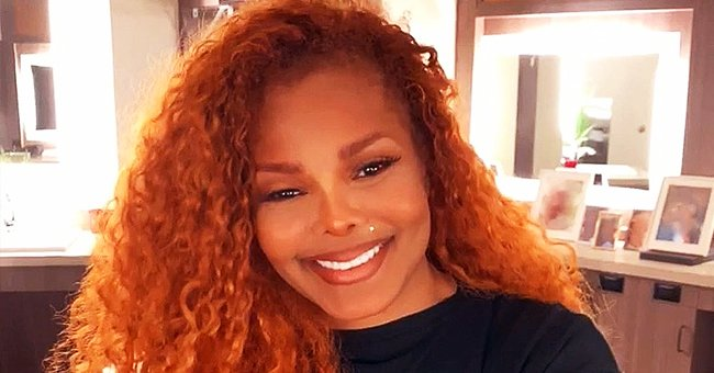 Janet Jackson Stuns in Long Red Tulle Skirt and Knee-High Boots in a New Photo