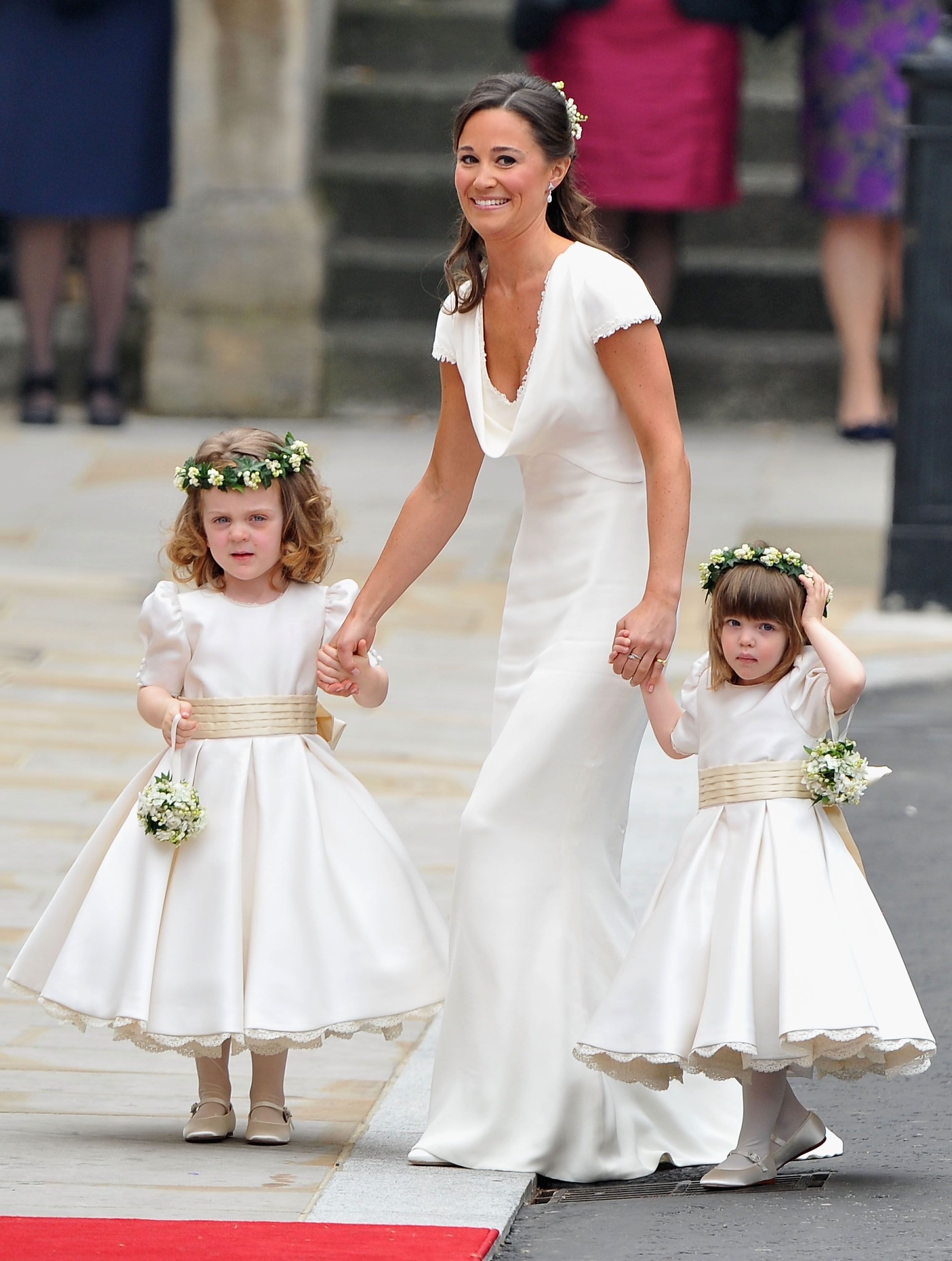 Sister of the bride and Maid of Honour Pippa Middleton holds hands with Grace Van Cutsem and Eliza Lopes as they arrive to attend the Royal Wedding of Prince William to Catherine Middleton at Westminster Abbey on April 29, 2011 | Photo: Getty Images