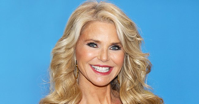 Christie Brinkley Shows off Her Ageless Body Gardening on the Beach in a Strapless Red Swimsuit