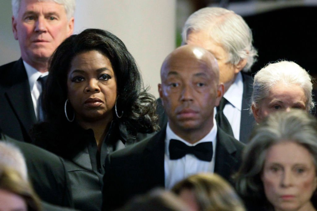 Oprah Winfrey and Russell Simmons attend the funeral of Eunice Kennedy Shriver , August 2009   Source: Getty Images