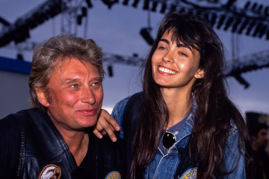 Johnny Hallyday et Adeline Blondieau. | Sources : Getty Images