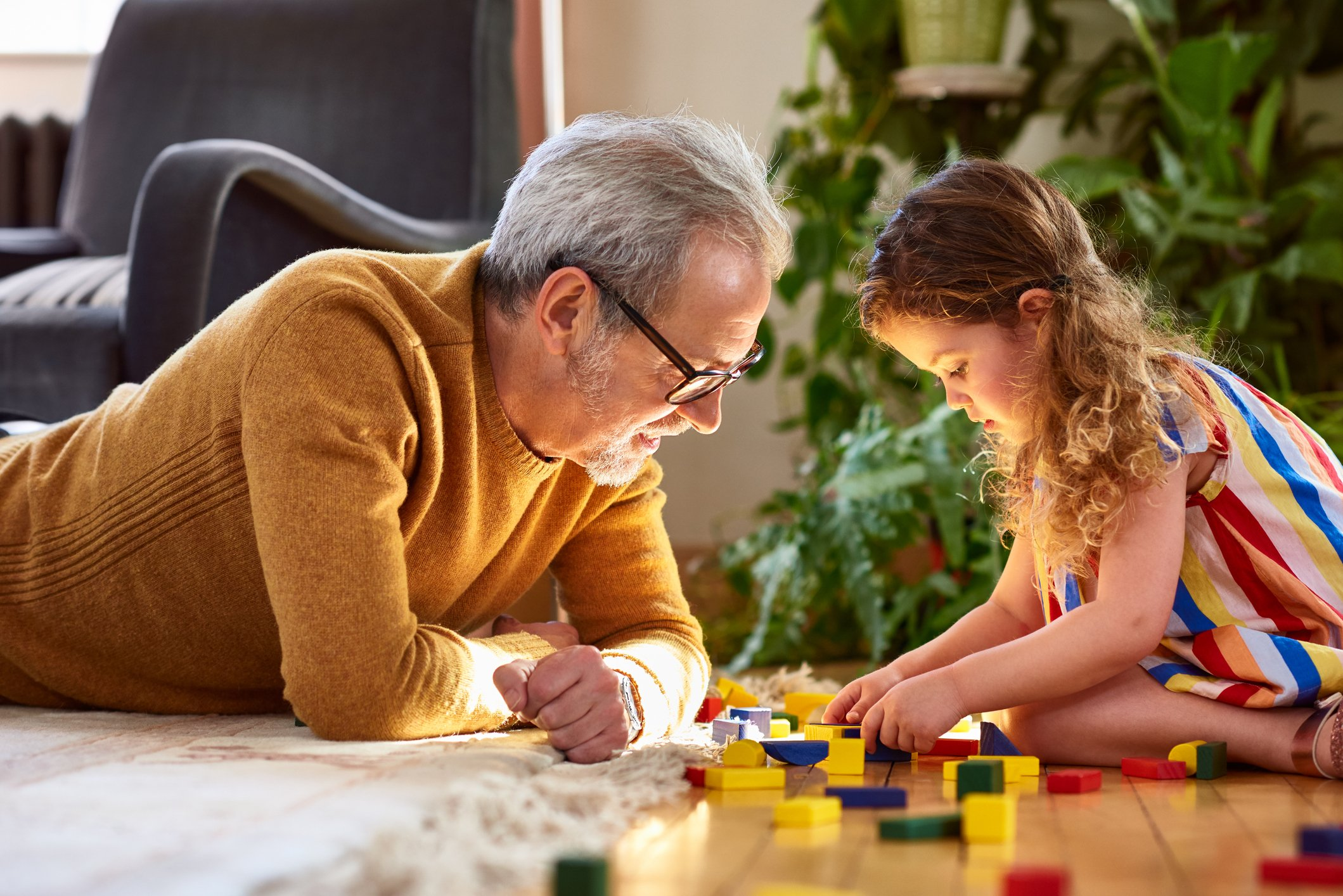 John loved watching his granddaughter play with her toys.   Photo: Getty Images
