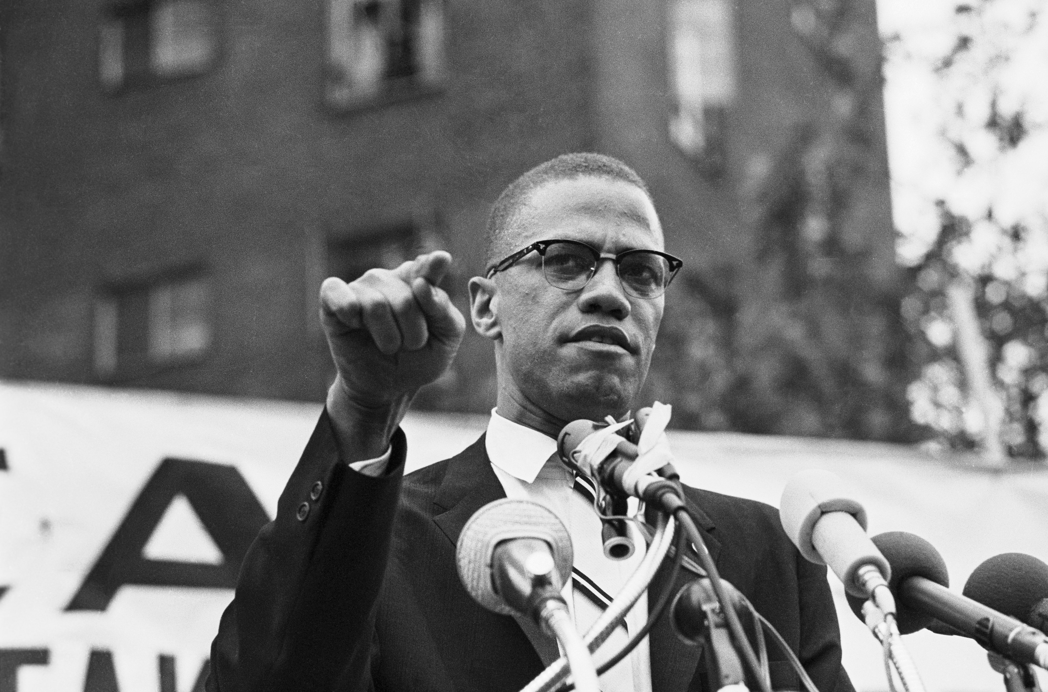 Nation of Islam leader Malcolm X speaking at a rally | Source: Getty Images