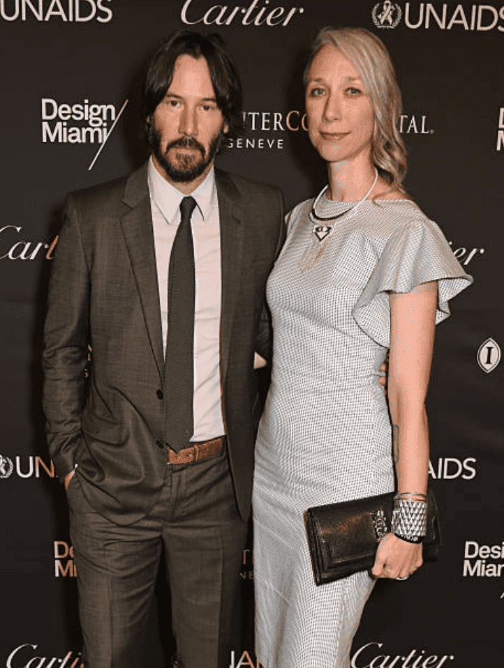 Keanu Reeves and Alexandra Grant pose on the red carpet at the UNAIDS Gala, on June 13, 2016 in Basel, Switzerland | Source: David M. Benett/Dave Benett/Getty Images