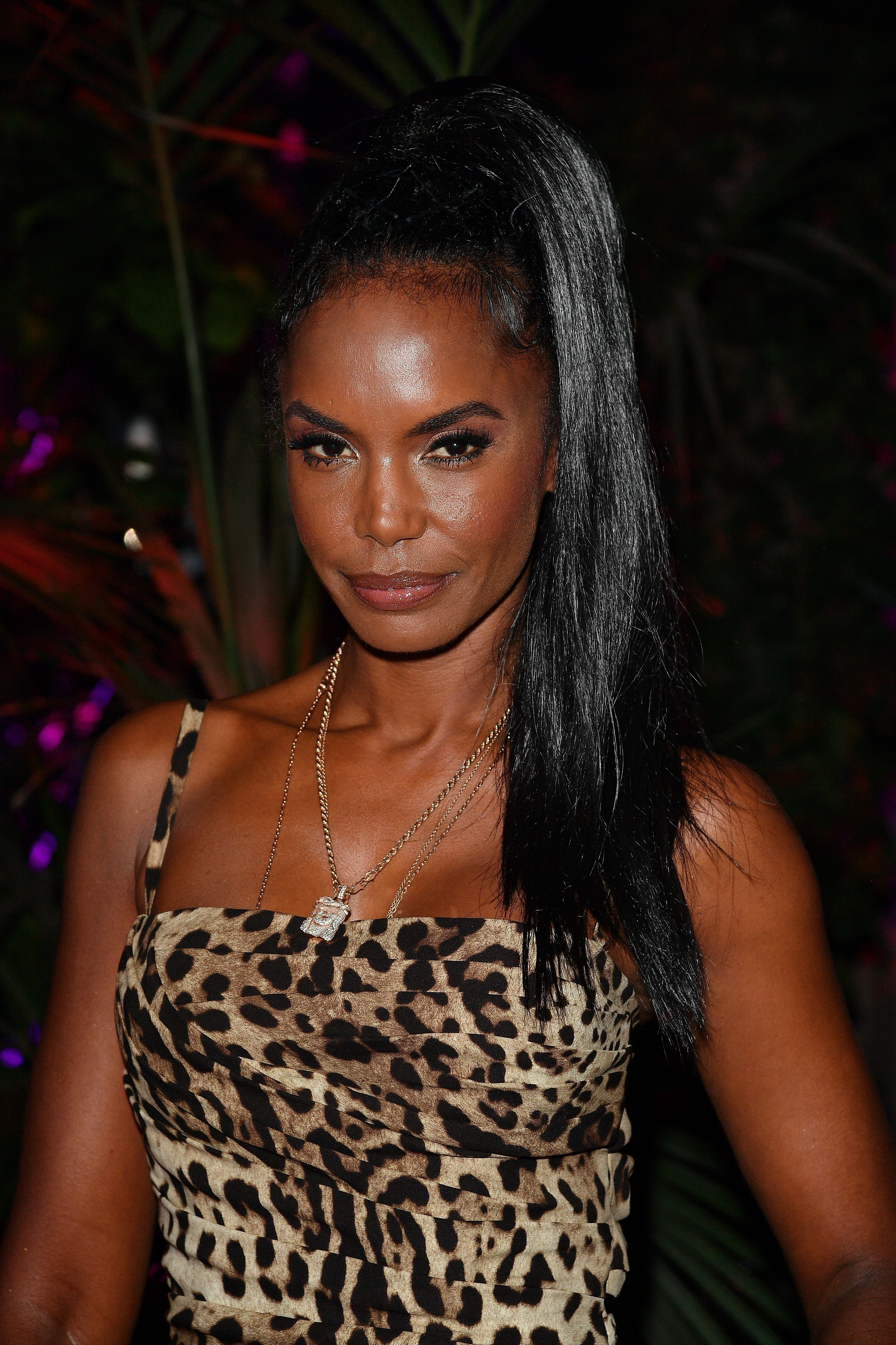 Kim Porter at Dolce & Gabbana party in September 2017. | Photo: Getty Images