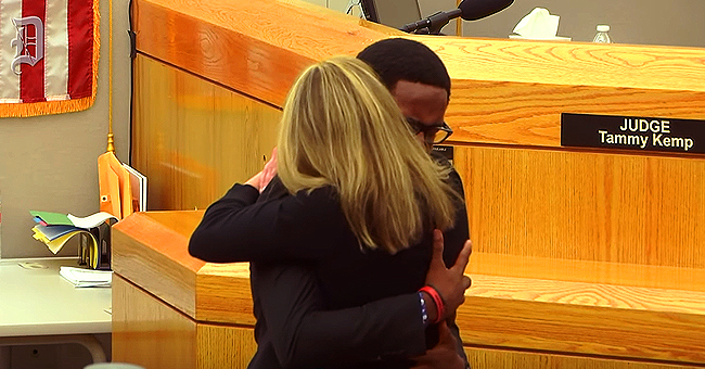 Botham Jean's Brother Hugs Amber Guyger after She Is Sentenced to 10 Years in Prison for Wrong-Apartment Killing