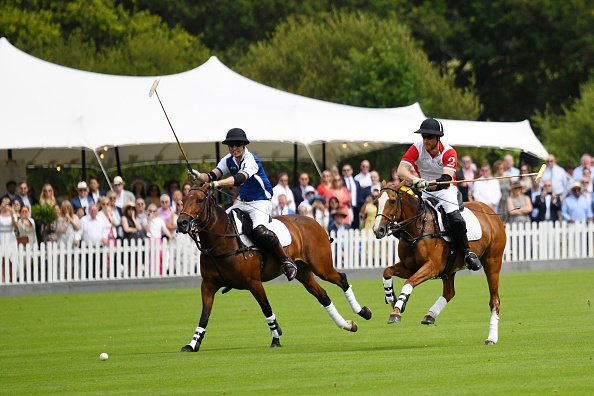 Prince William, Duke of Cambridge and Prince Harry, Duke of Sussex compete at the King Power Royal Charity Polo Day for the Vichai Srivaddhanaprabha Memorial Trophy at Billingbear Polo Club on July 10, 2019, in Wokingham, England. | Source: Getty Images.