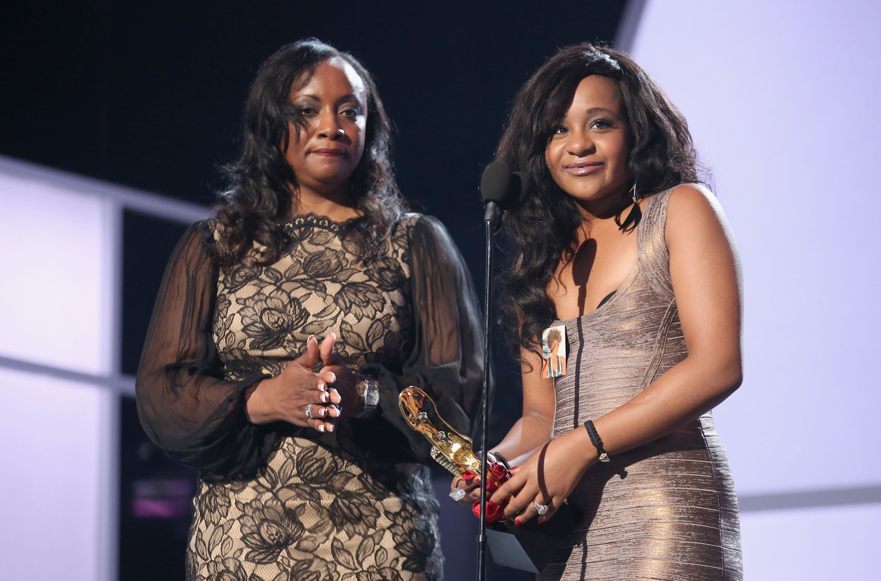 Bobbi Kristina Brown & her aunt Pat accept the Millennium Award on behalf of Whitney Houston at the Billboard Music Awards in 2012 | Photo: Getty Images