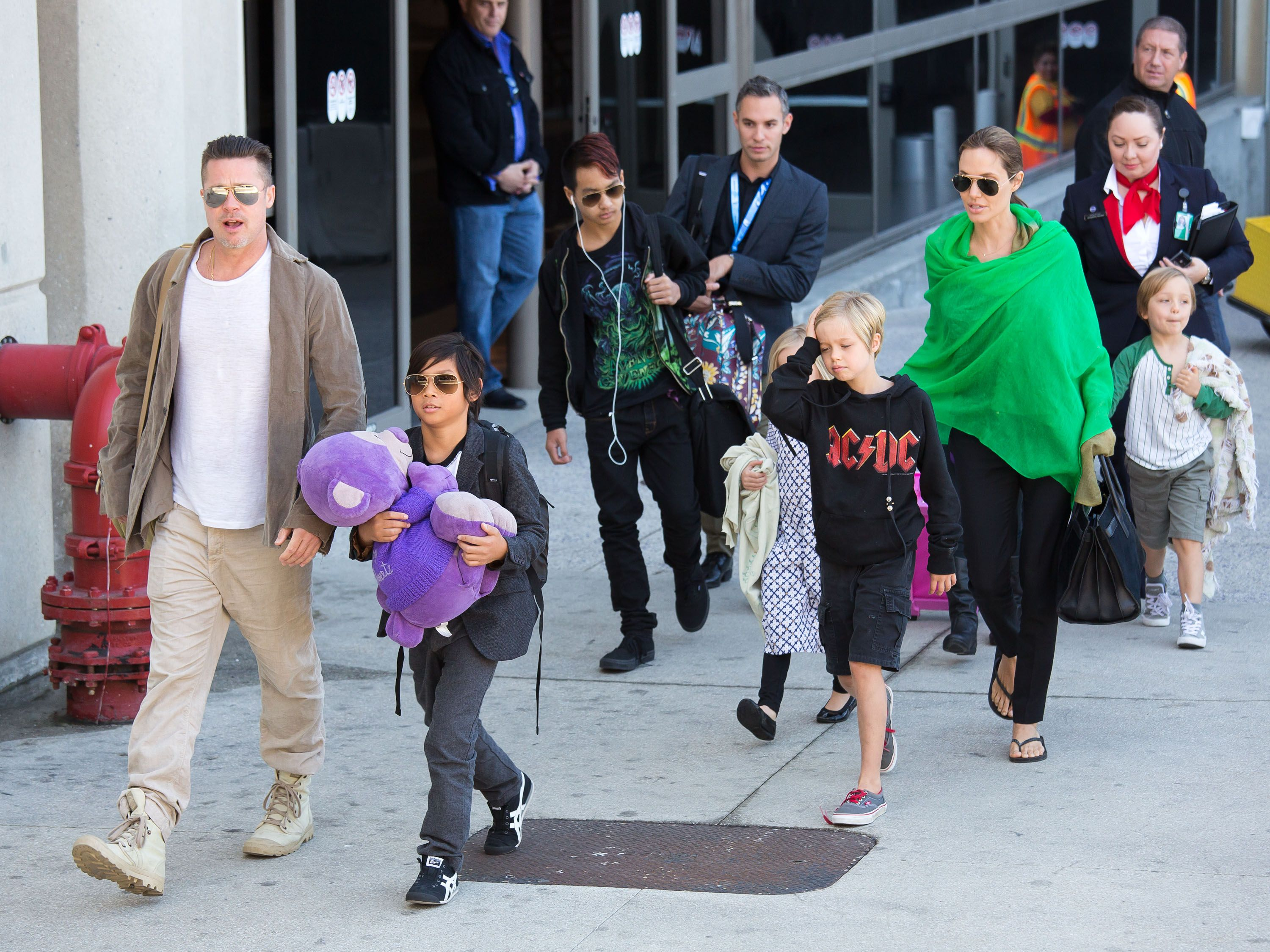 Brad Pitt and Angelina Jolie are seen after landing at Los Angeles International Airport with their children on February 05, 2014 | Photo: Getty Images