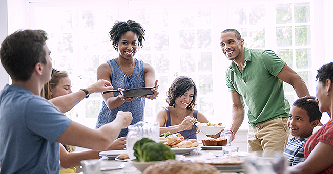 Daily Joke: A Family Gathers around the Table for Dinner