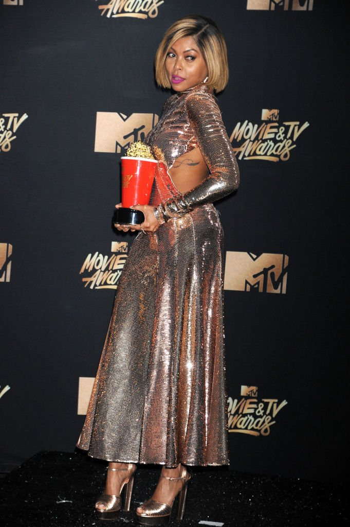 """Actress Taraji P. Henson, winner of Best Fight Against the System for """"Hidden Figures"""" shows off her tattoo in the press room during the 2017 MTV Movie And TV Awards on May 7, 2017. 