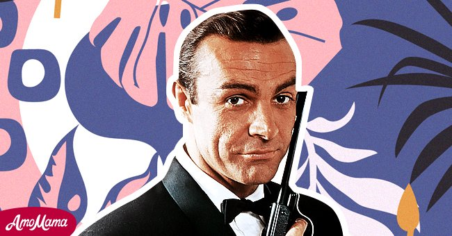 Portrait of Sean Connery, starring as James Bond, with a gun against the side of his face. | Photo: Getty Images