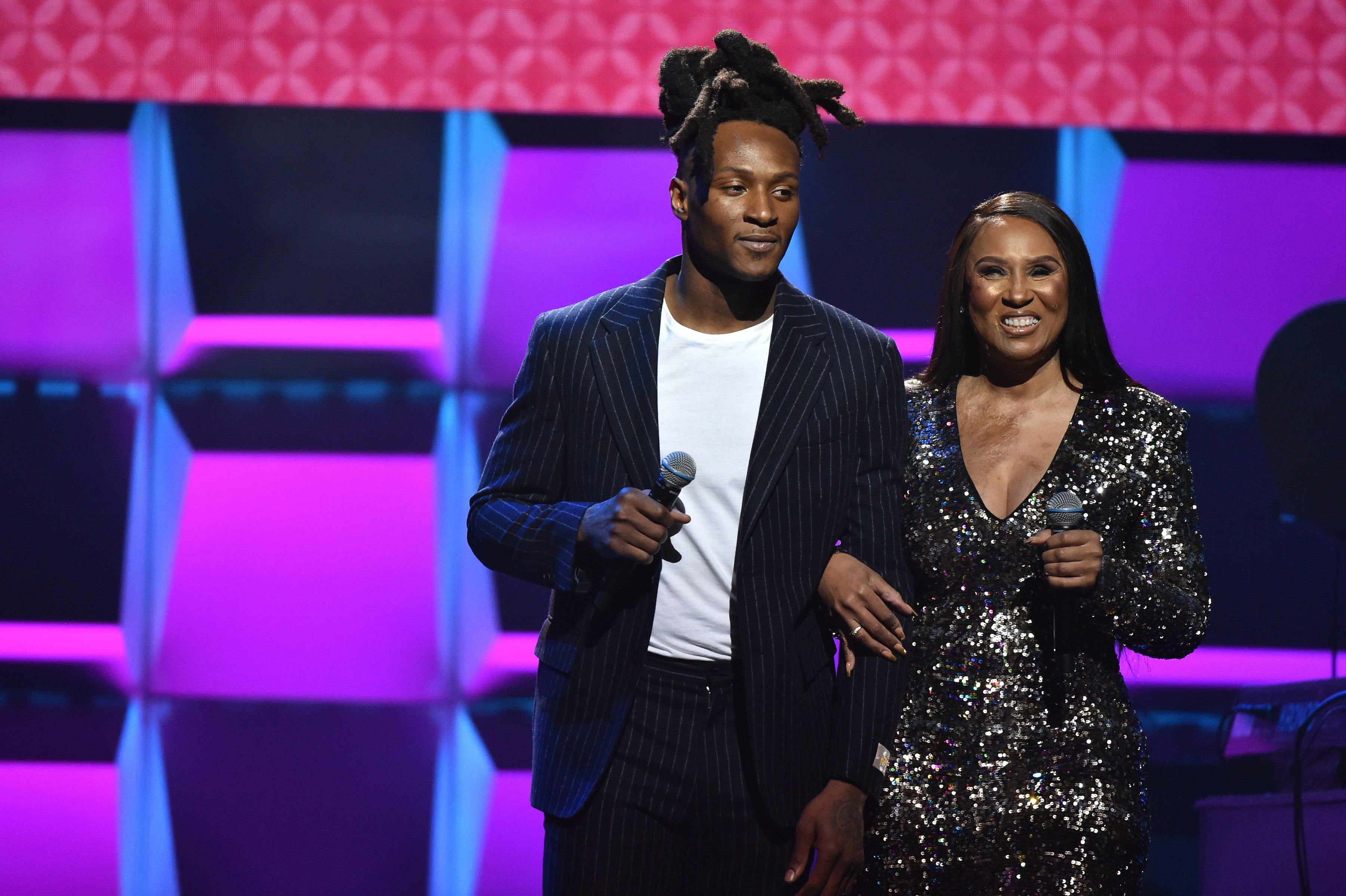 DeAndre Hopkins and Sabrina Greenlee onstage during the BET Super Bowl Gospel Celebration in January 2020 in Miami, Florida | Source: Getty Images