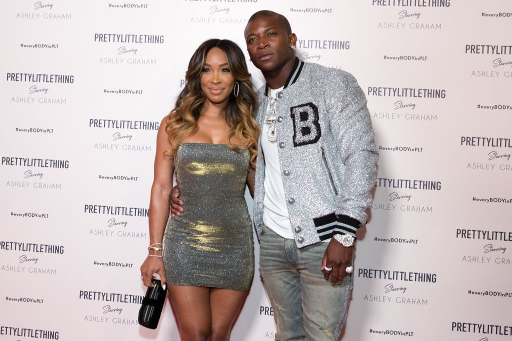 Malika Haqq and OT Genasis arrive on the red carpet at the PrettyLittleThing x Ashley Graham Event on September 24, 2018, in West Hollywood, California | Source: Greg Doherty/Getty Images