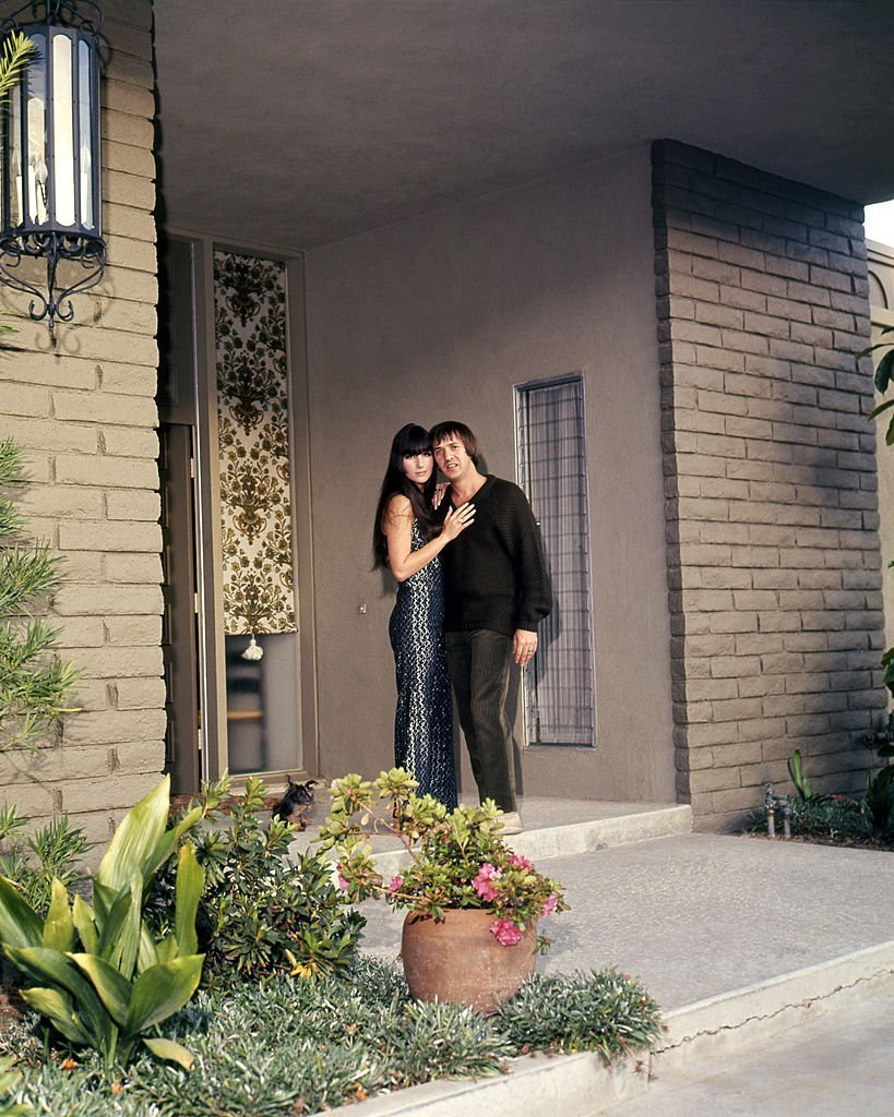 Sonny & Cher at the entrance to their house, in Encino, California, | Getty Images