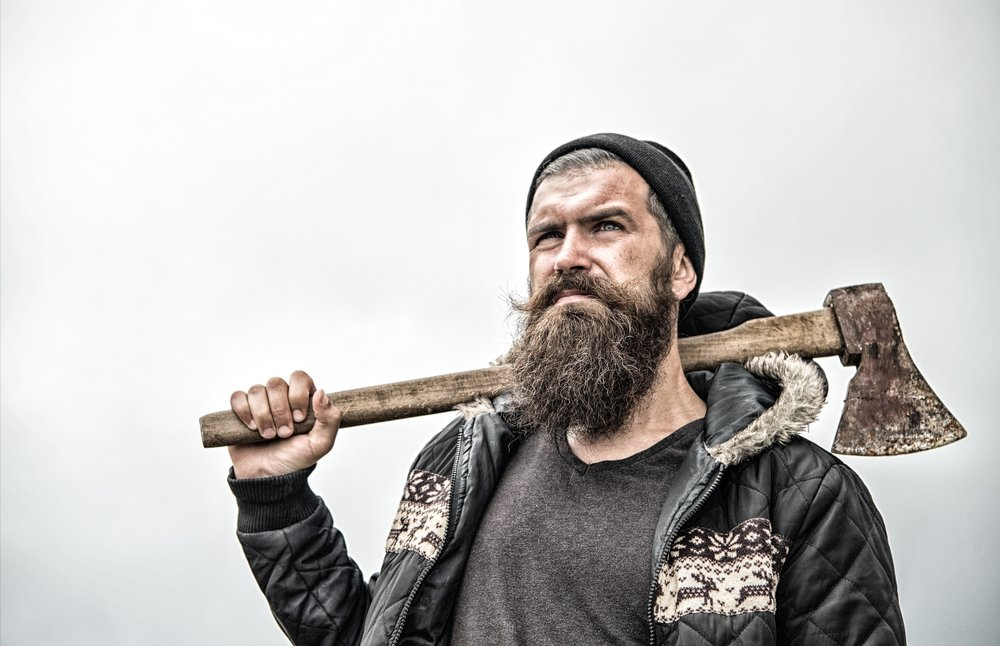 A Lumberjack holding an axe on his shoulder. | Photo: Shutterstock