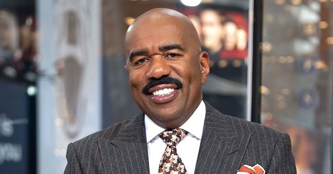 Inside Steve Harvey's $15M House with a Sparkling Pool, Gigantic Gym, & Imperial Staircase