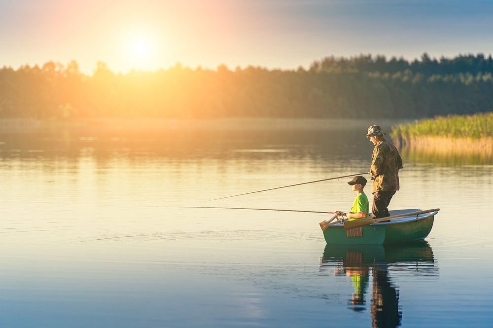 A man and a boy on a fishing boat | Photo: Shutterstock