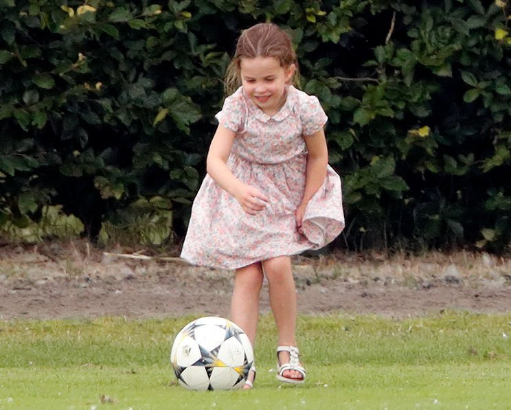Princess Charlotte plays football as she attends the King Power Royal Charity Polo Match | Photo: Getty Images