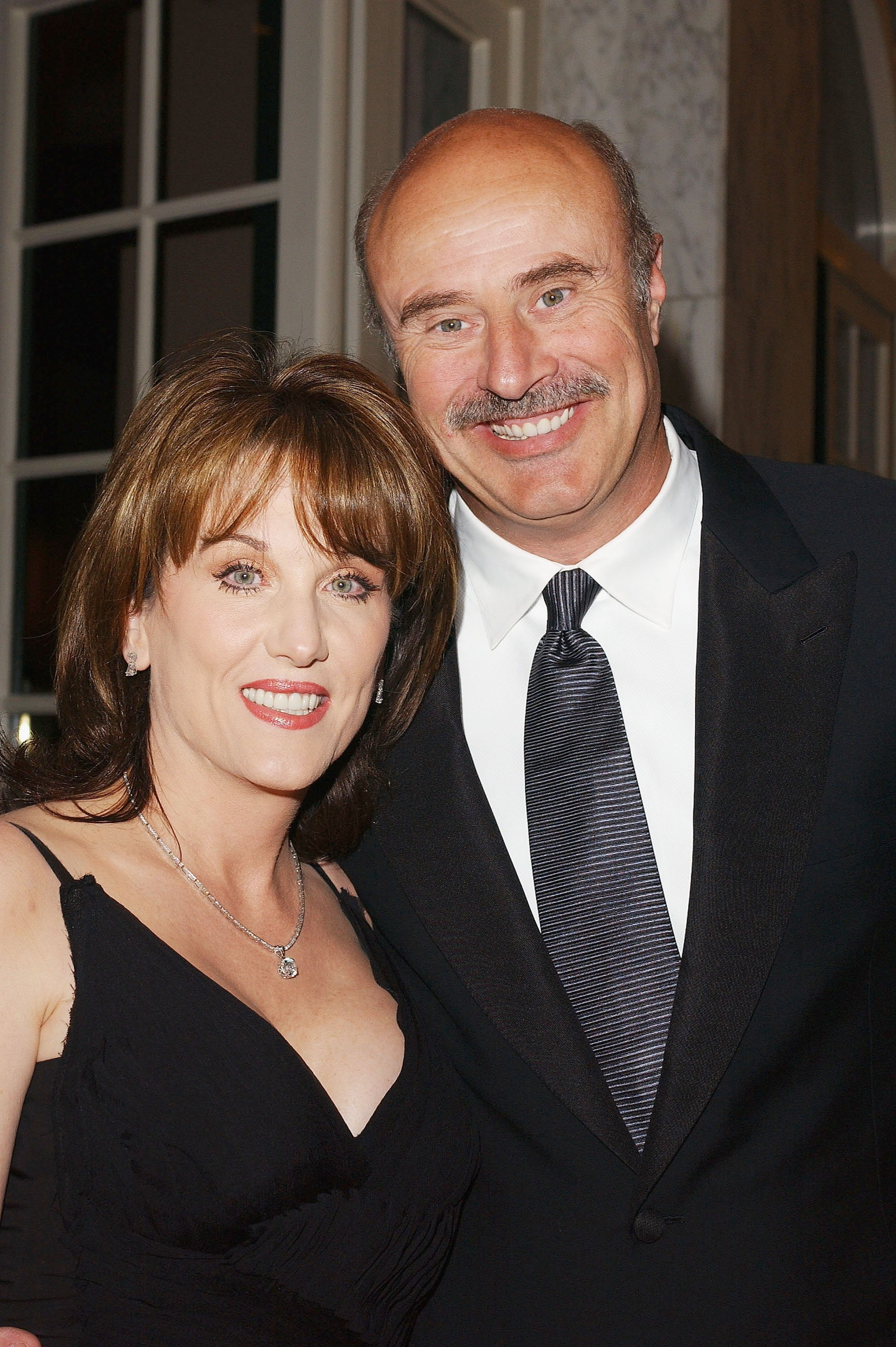 Dr. Phil McGraw and his wife Robin on March 12, 2004, in Beverly Hills, California. | Source: Getty Images