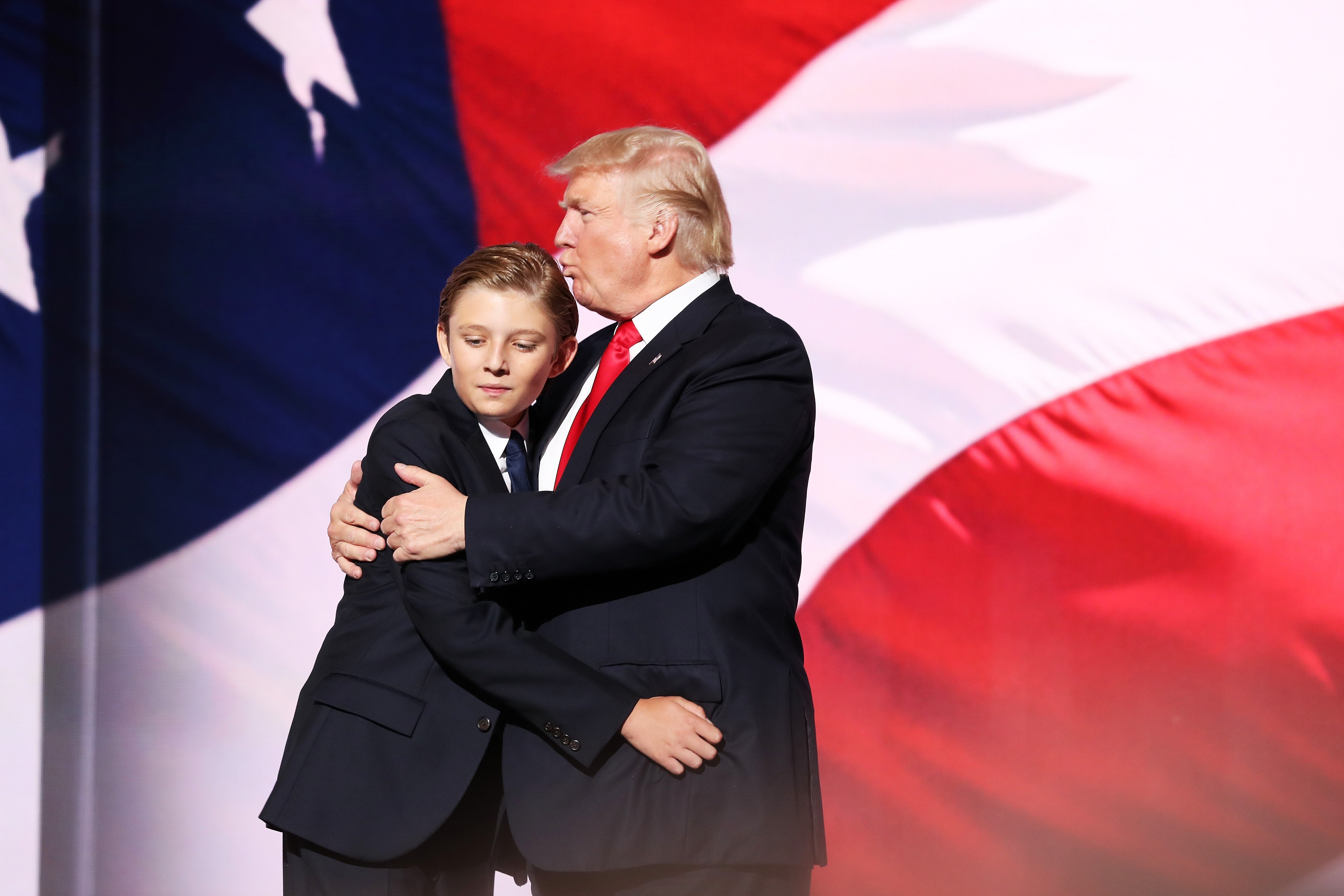 Donald embraces his son Barron Trump after he delivered his speech on the fourth day of the Republican National Convention on July 21, 2016 in Cleveland, Ohio | Photo: Getty Images