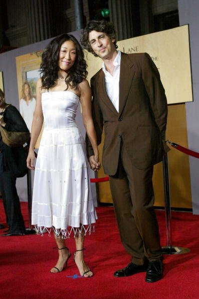 "Sandra Oh and Alexander Payne attend the film premiere of ""Under The Tuscan Sun"" at the El Capitan Theatre on September 20, 2003, in Hollywood, California. 