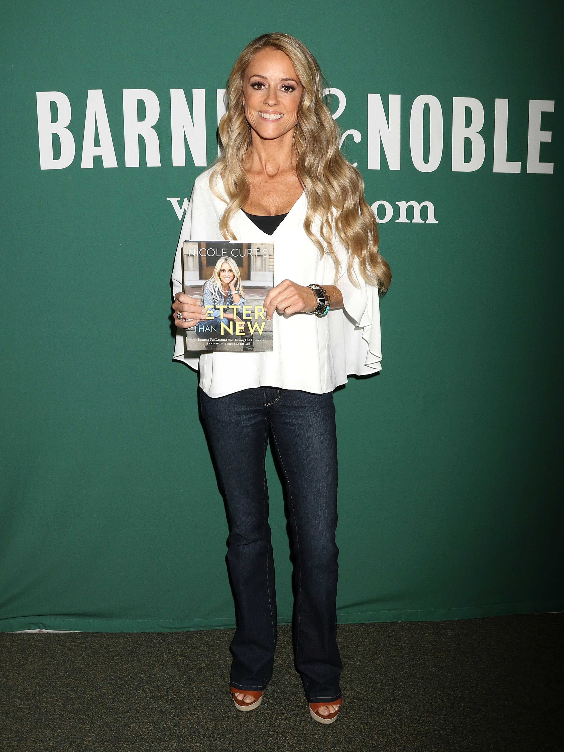 """Nicole Curtis signs copies of her new book """"Better Than New: Lessons I've Learned from Saving Old Homes (and How They Saved Me)"""" at Barnes & Noble Union Square on October 18, 2016 