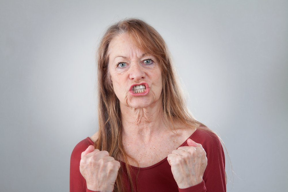 A portrait of a senior woman looking angry. | Photo: Shutterstock
