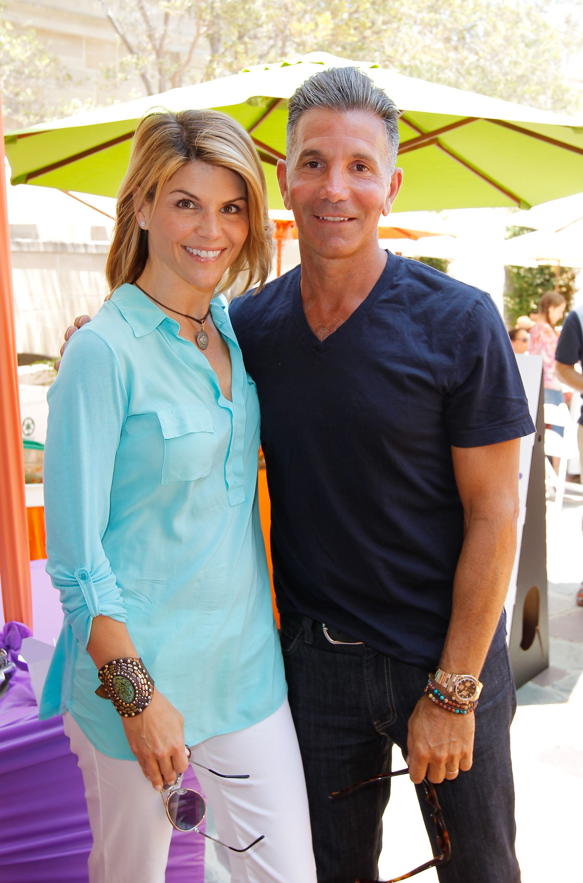 Lori Loughlin and Mossimo Giannulli during the 6th Annual Kidstock Music And Arts Festival Sponsored By Hudson Jeans at Greystone Mansion on June 3, 2012 in Beverly Hills, California.   Source: Getty Images