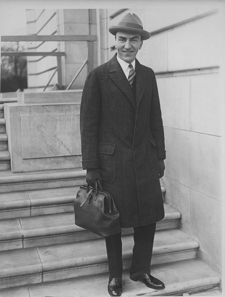 Captain Edward Vernon Rickenbacker leaves the offices of the House Aircraft Inquiry Committee, 1925   Source: Getty Images