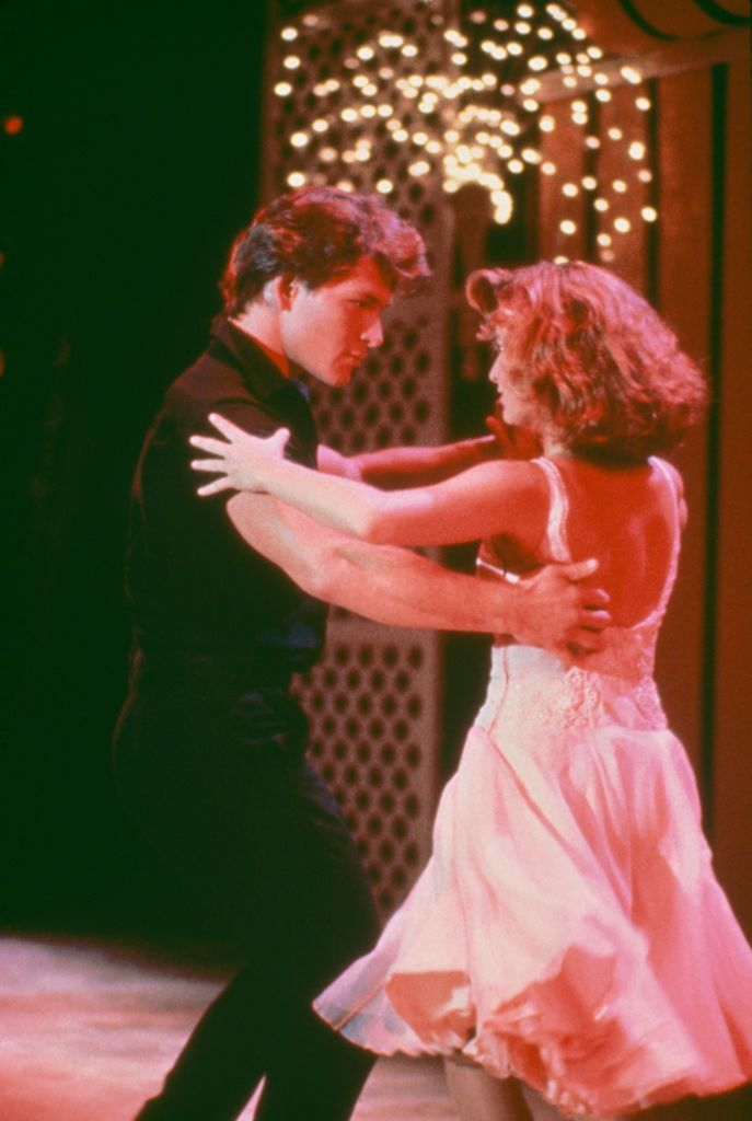"Late actor Patrick Swayze as Johnny Castle and actress Jennifer Grey as Frances ""Baby"" Houseman dancing during a scene from ""Dirty Dancing"" in 1987 