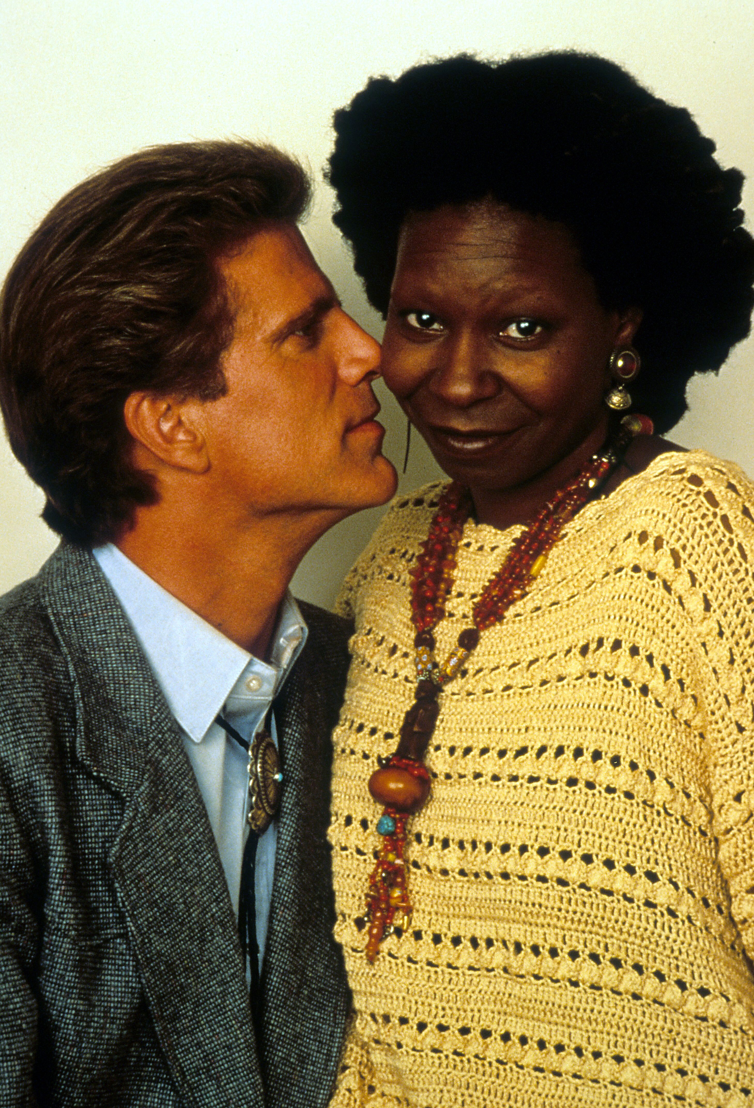 Whoopi Goldberg not amused by Ted Danson's face right up next to her in a scene from the film 'Made In America', 1993. | Source: Getty Images