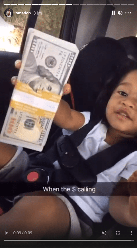 A screenshot from a video of Omarion's daughter, A'mei Kazuko Grandberry with wads of cash on Instagram   Photo: Instagram/omarion