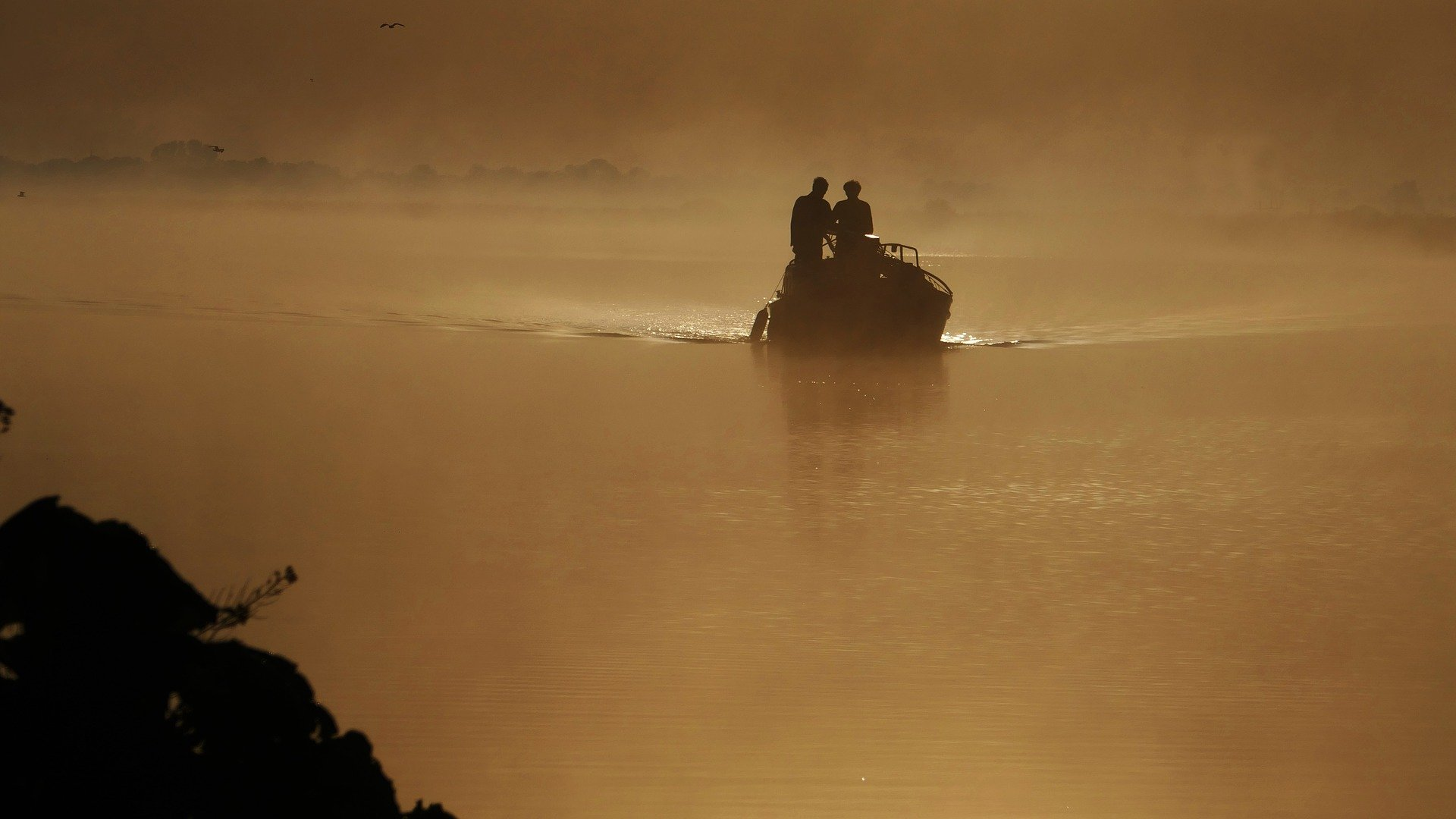 Pictured - Two individuals on a boat in the river channel | Photo: Getty Images