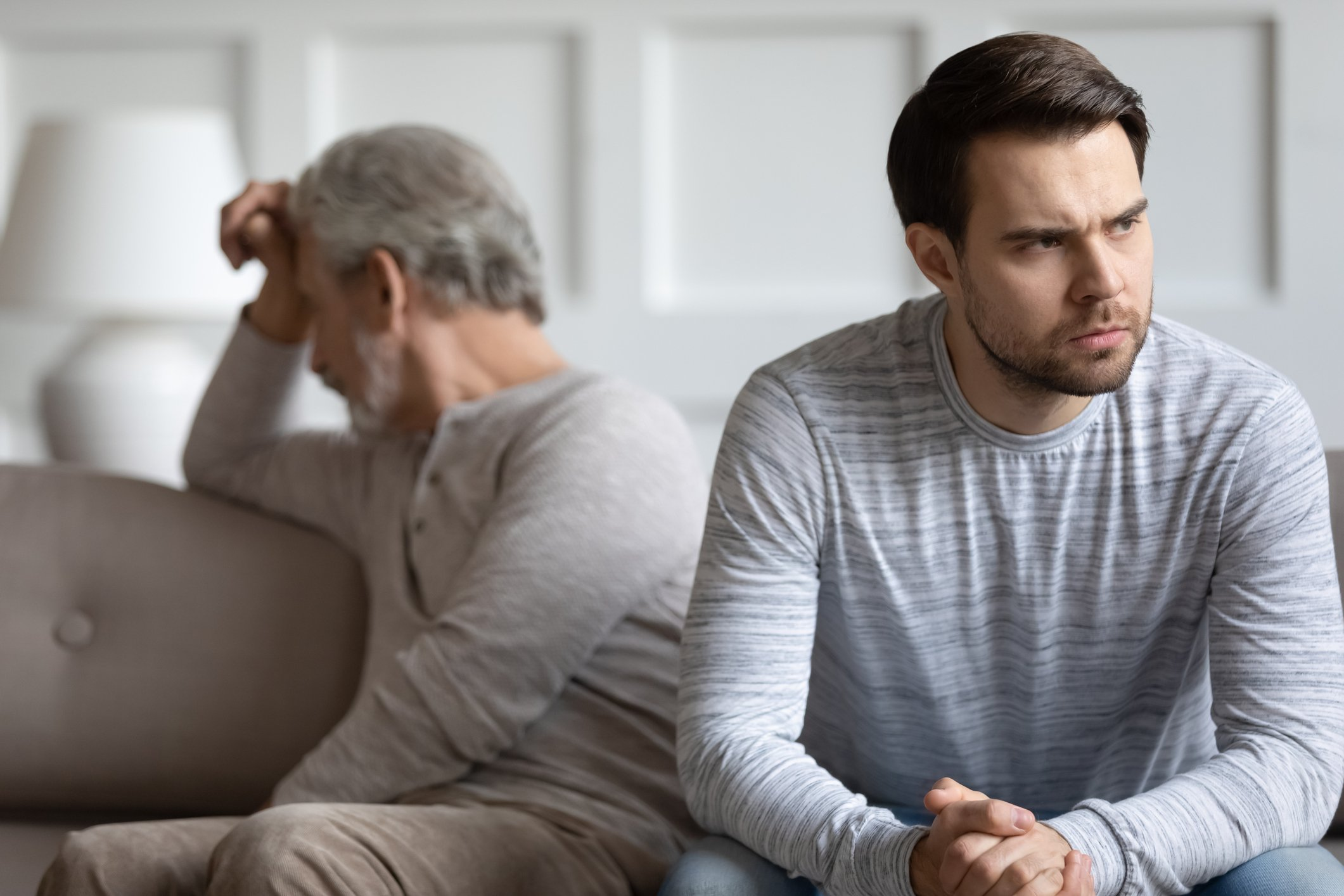 Father and son refuse to talk after a heated argument | Photo: Getty Images