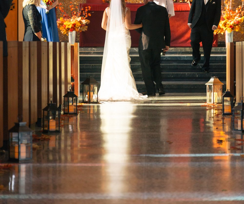 Bride and Her Father Walking Down Aisle in Church | Photo: Shutterstock