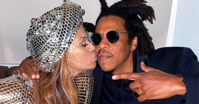 Beyoncé Kisses Husband Jay-Z in a Cute Photo as She Celebrates Record-Breaking Grammy Awards