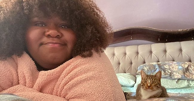 Gabby Sidibe Flaunts Afro in Pink Outfit While Lying on the Bed with Her Cat — So Cute!