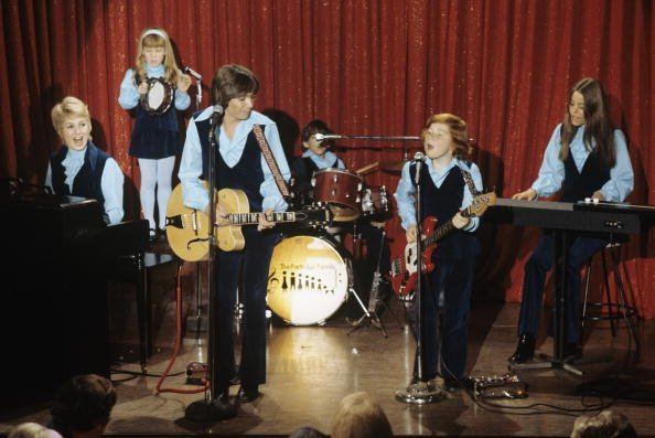 "Suzanne Crough and the rest of the members of ""The Partridge Family"" playing together 