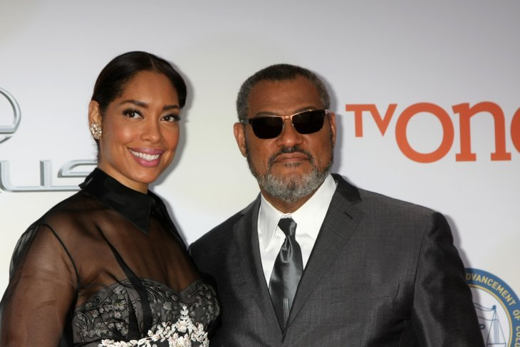 Gina Torres and Laurence Fishburne at the 46th NAACP Image Awards Arrivals at a Pasadena Convention Center on February 6, 2015  | Photo: Getty Images