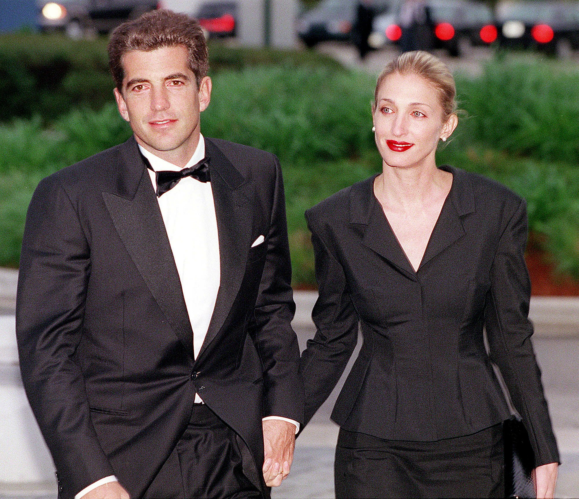 John F. Kennedy, Jr. and his wife Carolyn Bessette Kennedy arrive at the annual John F. Kennedy Library Foundation dinner and Profiles in Courage awards on May 23, 1999, in Boston, MA. | Source: Getty Images.