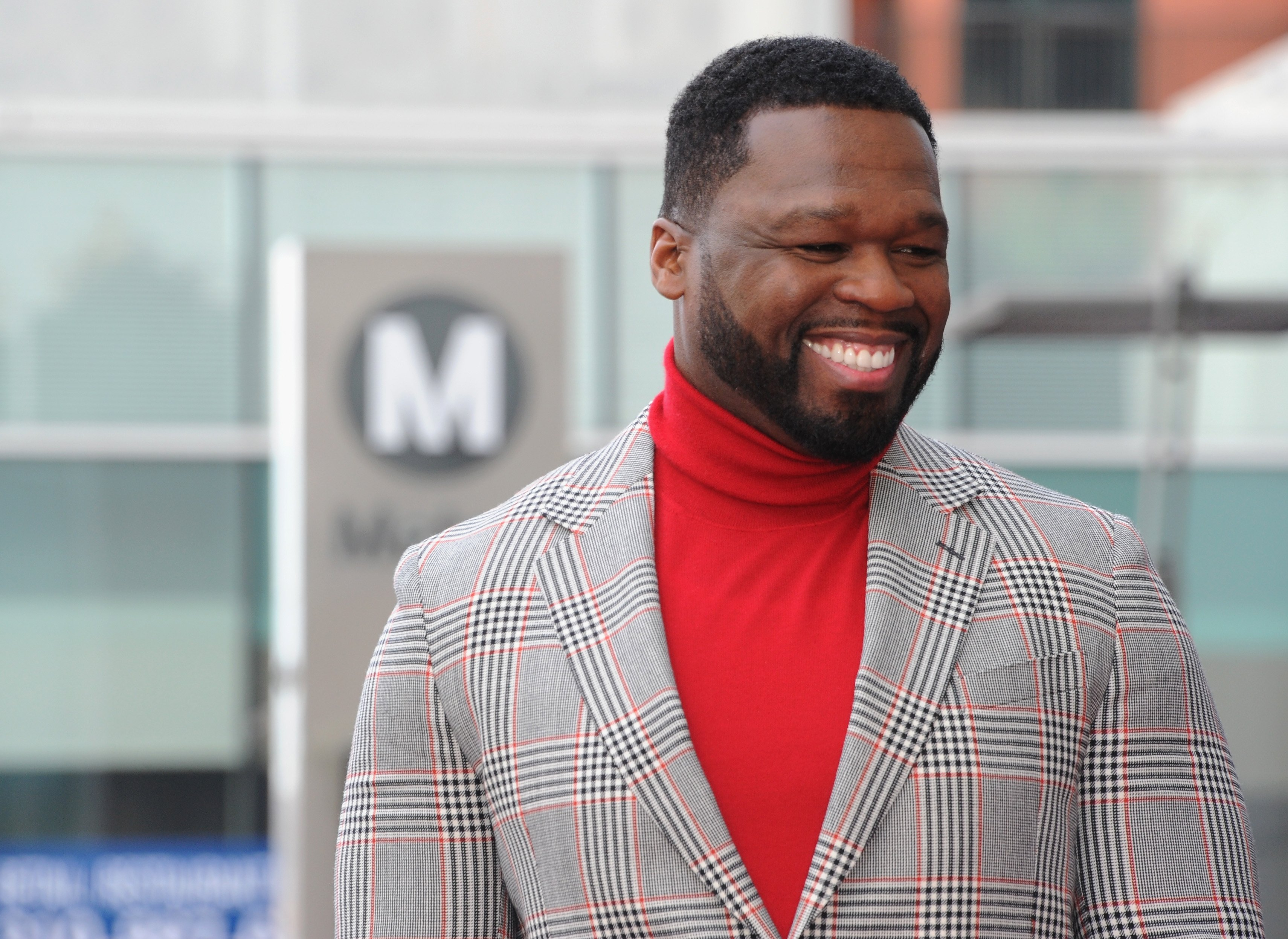 """Curtis """"50 Cent"""" Jackson smiles as he is honored with a star on the Hollywood Walk of Fame on January 30, 2020 in Hollywood, California. 