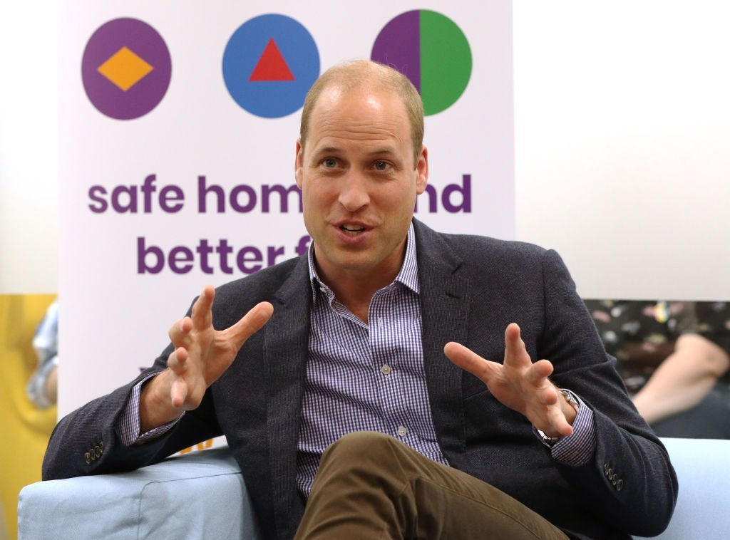 Prince William, Duke of Cambridge speaks to former and current service users during a visit to the Albert Kennedy Trust | Photo: Getty Images