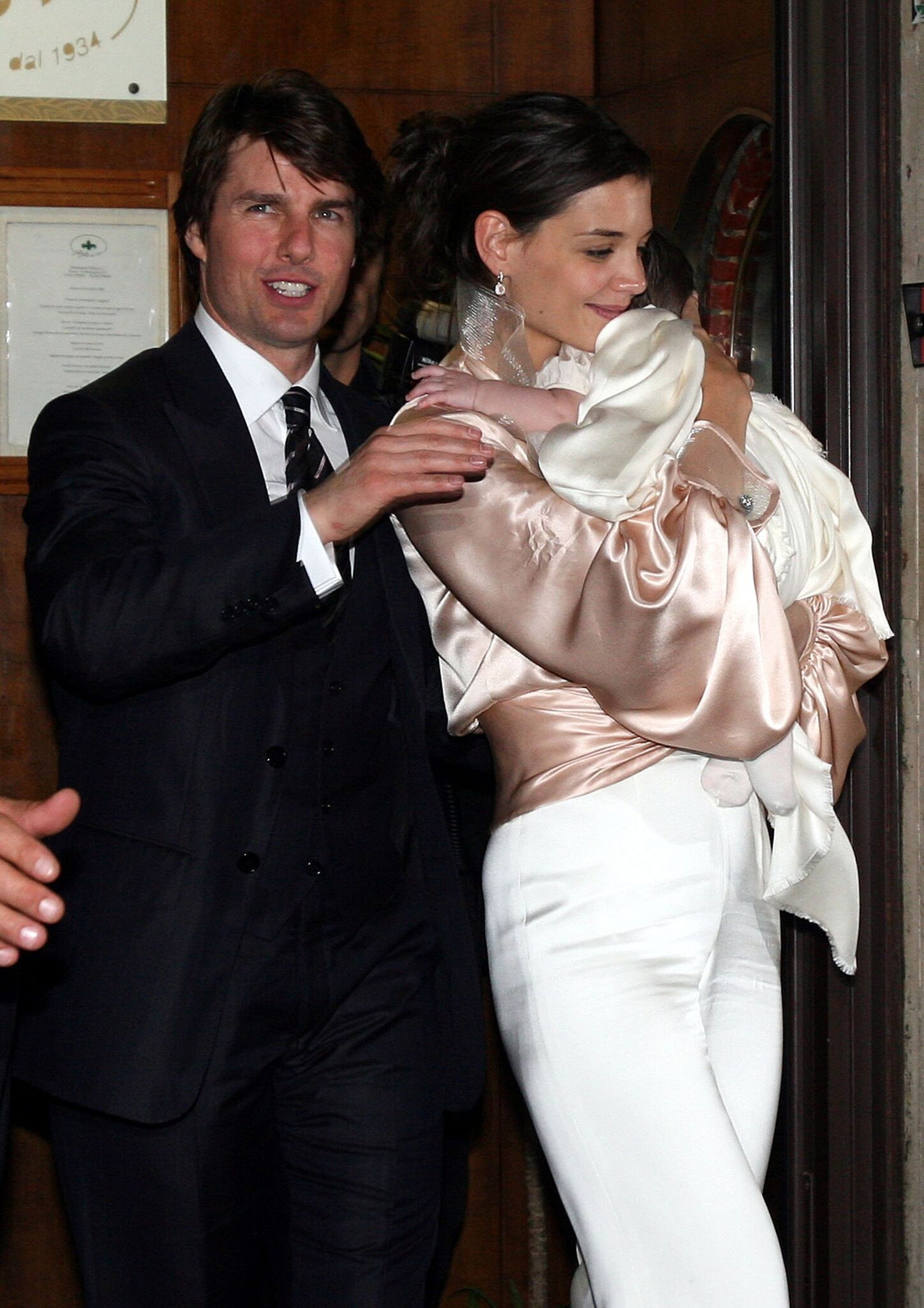 Tom Cruise, Katie Holmes and their daughter Suri leave the restaurant in central Rome, as part of Katie Holmes and Tom Cruise wedding | Getty Images