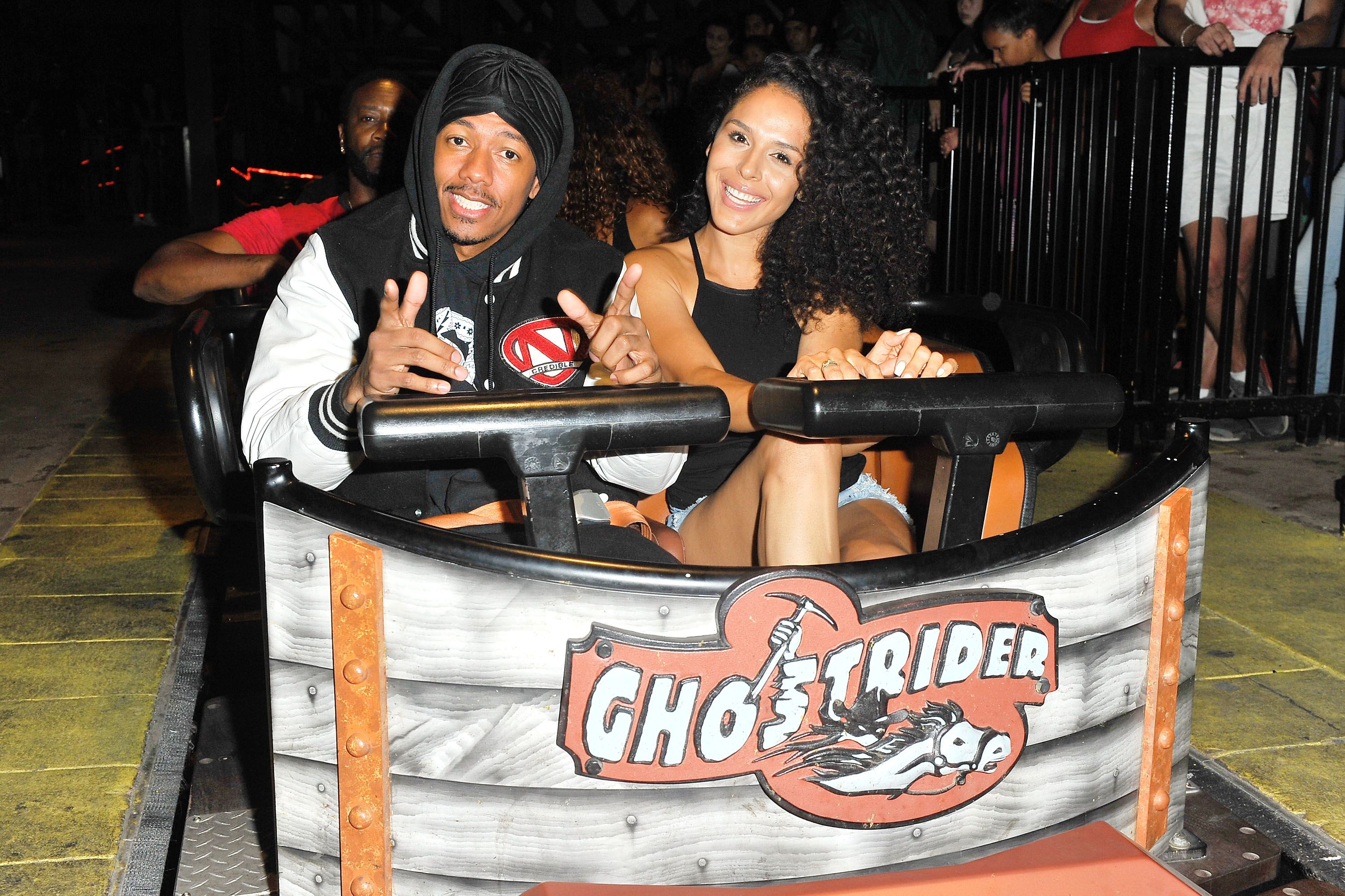 """Nick Cannon and Brittany Bell at the """"Ghostrider"""" Roller Coaster at Knott's Berry Farm on September 1, 2017 in Buena Park, California. 