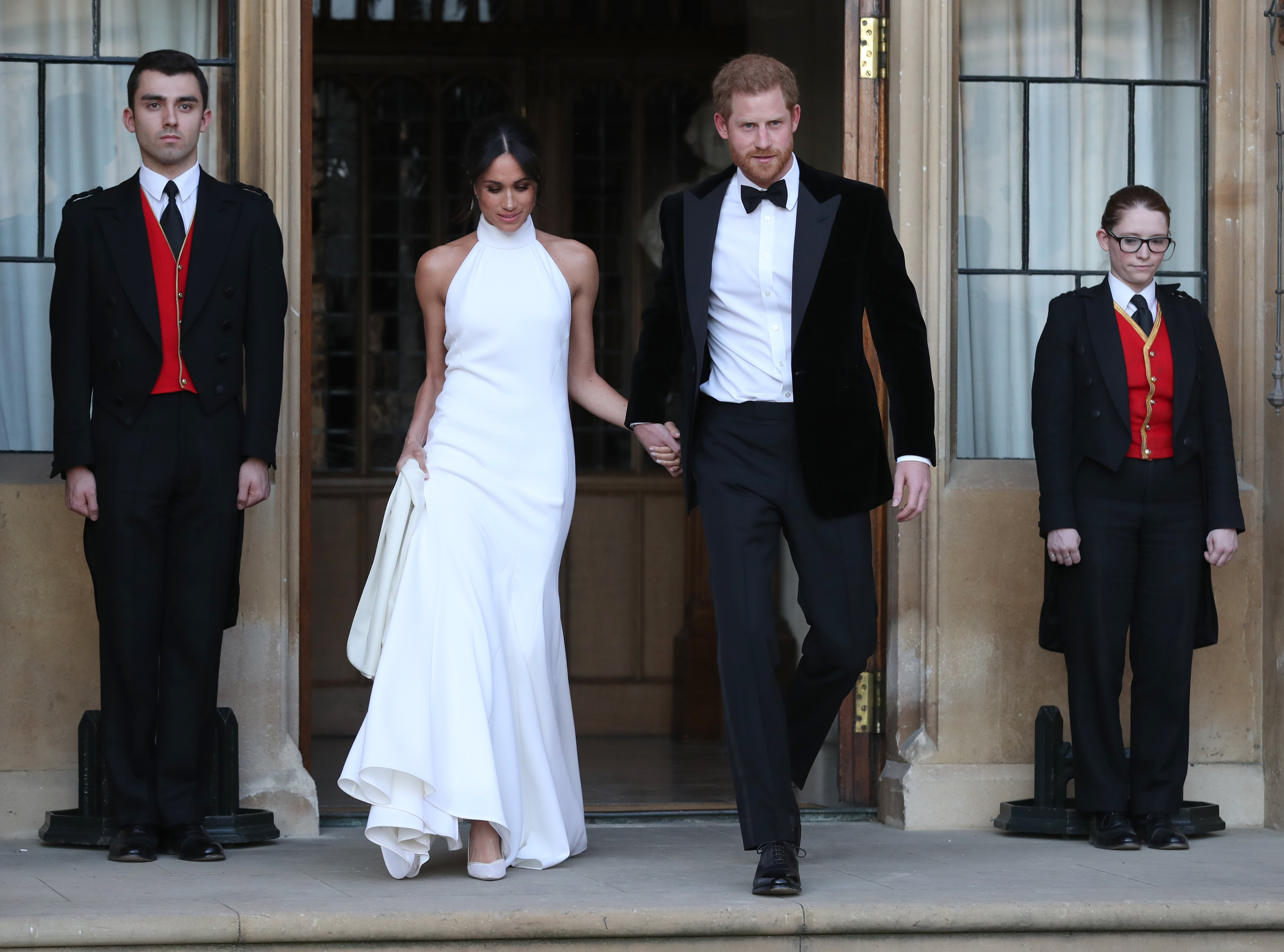 Duchess of Sussex and Prince Harry, Duke of Sussex leave Windsor Castle after their wedding to attend an evening reception at Frogmore House, hosted by the Prince of Wales on May 19, 2018| Photo: Getty Images