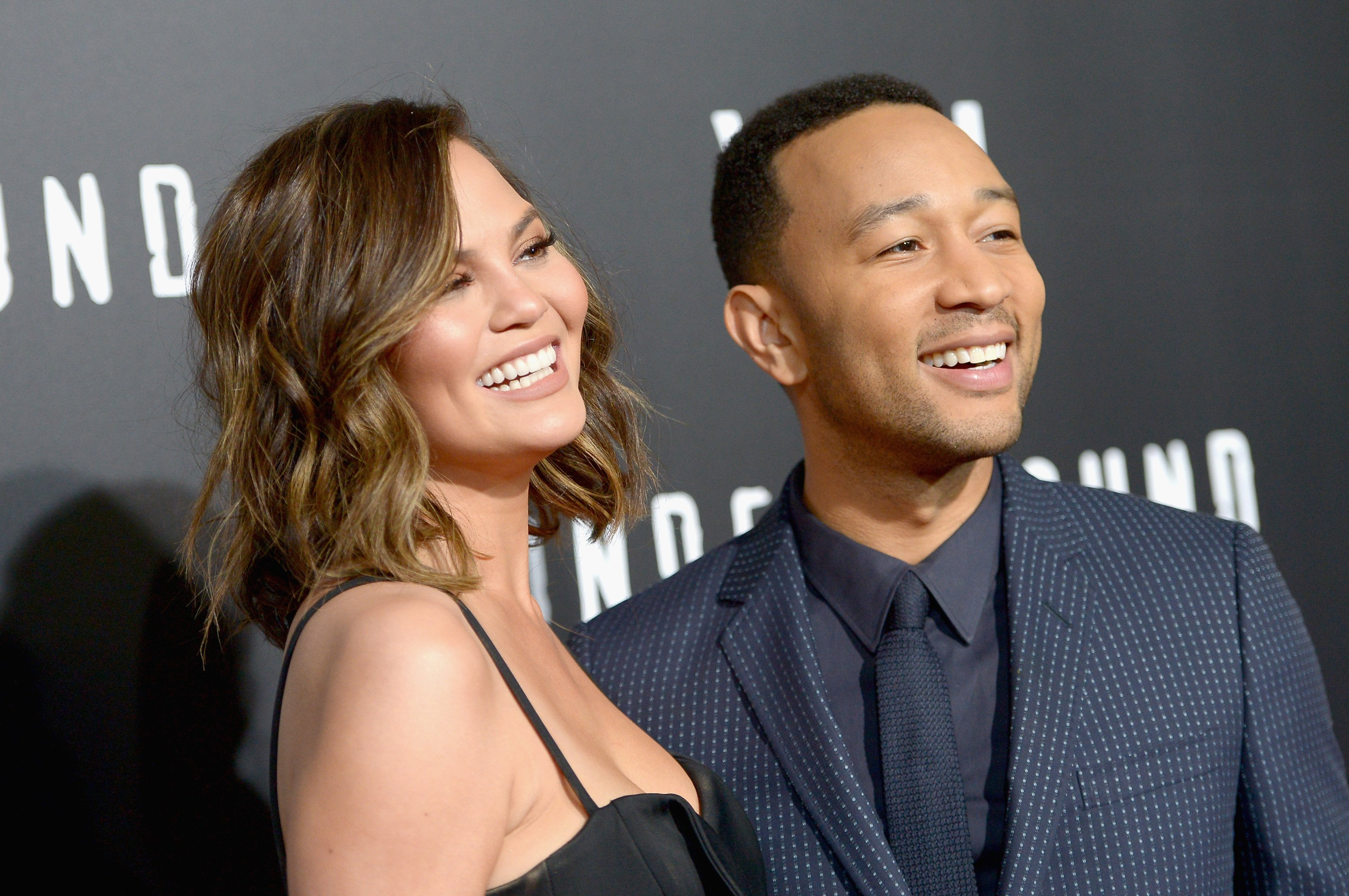 """Chrissy Teigen and John Legend attending WGN America's """"Underground"""" Season Two Premiere Screening at Regency Village Theatre on March 1, 2017 in California.   Photo by Charley Gallay/Getty Images"""